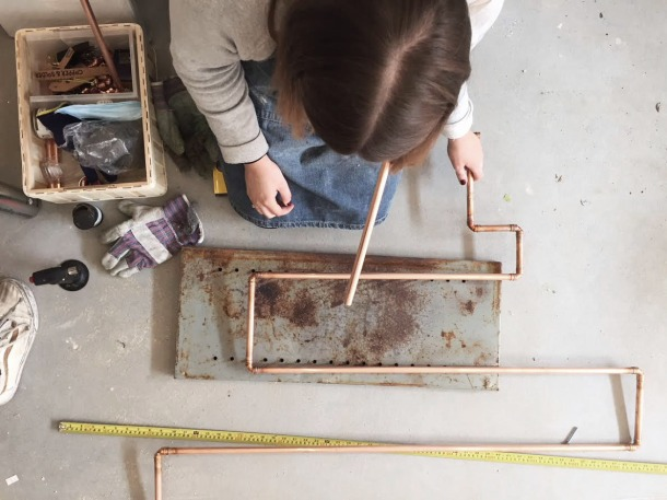 Katie works on a bespoke copper piece